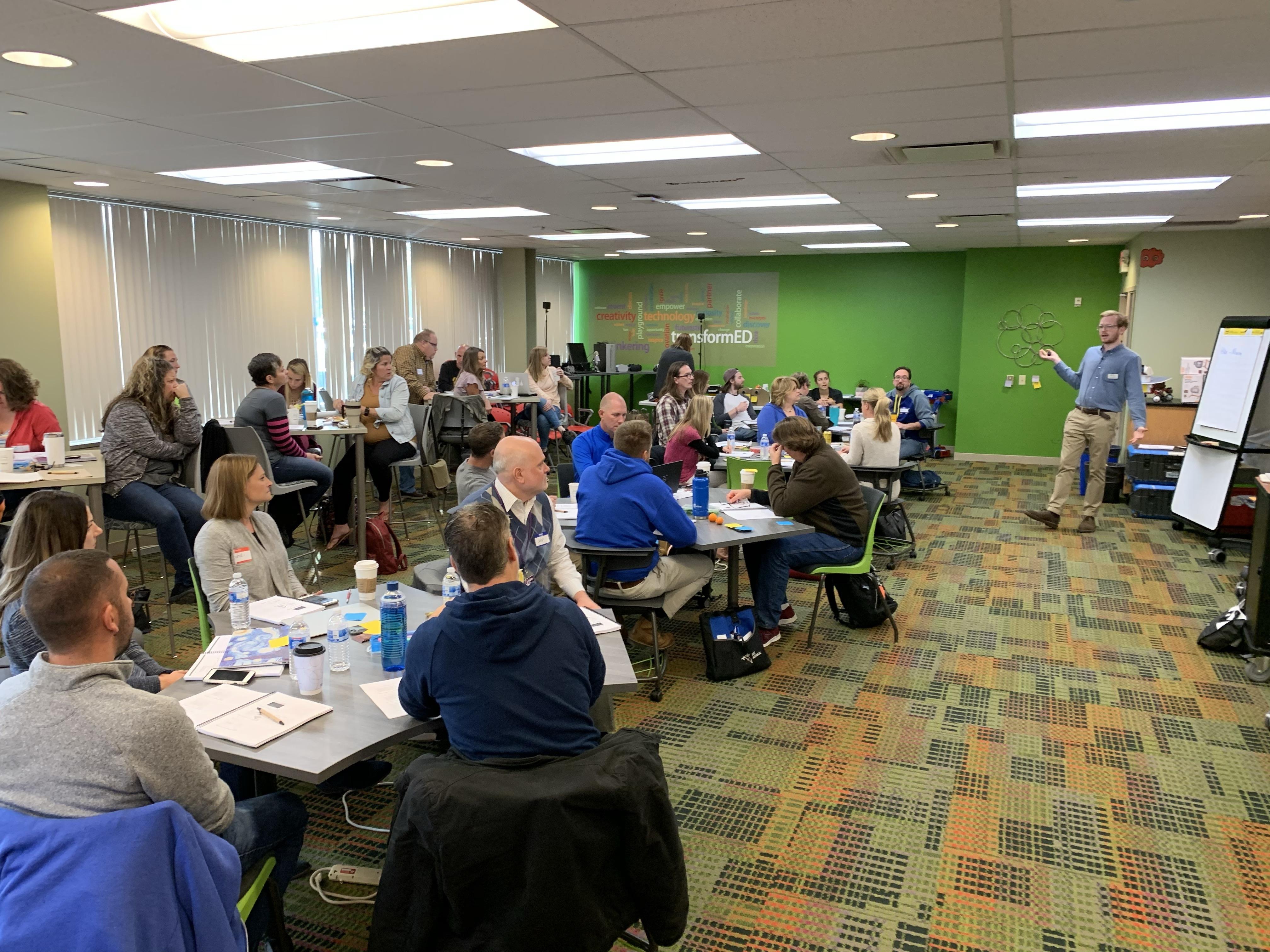 Educators in a STEM education training, listening to presentation on renewable energy