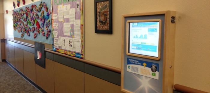 Wall-mount solar data display kiosk